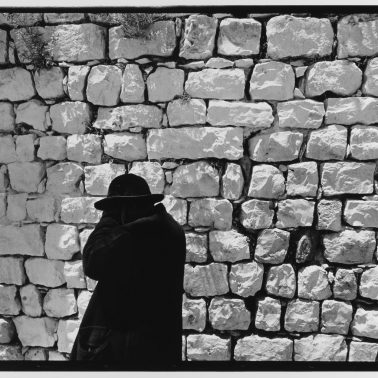 Black Coat White Wall, Jerusalem, Israel, 1967 by Leonard Freed