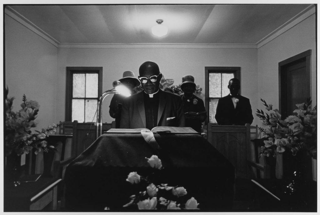 Minister reads from bible, John's Island, SC, 1965 by Leonard Freed