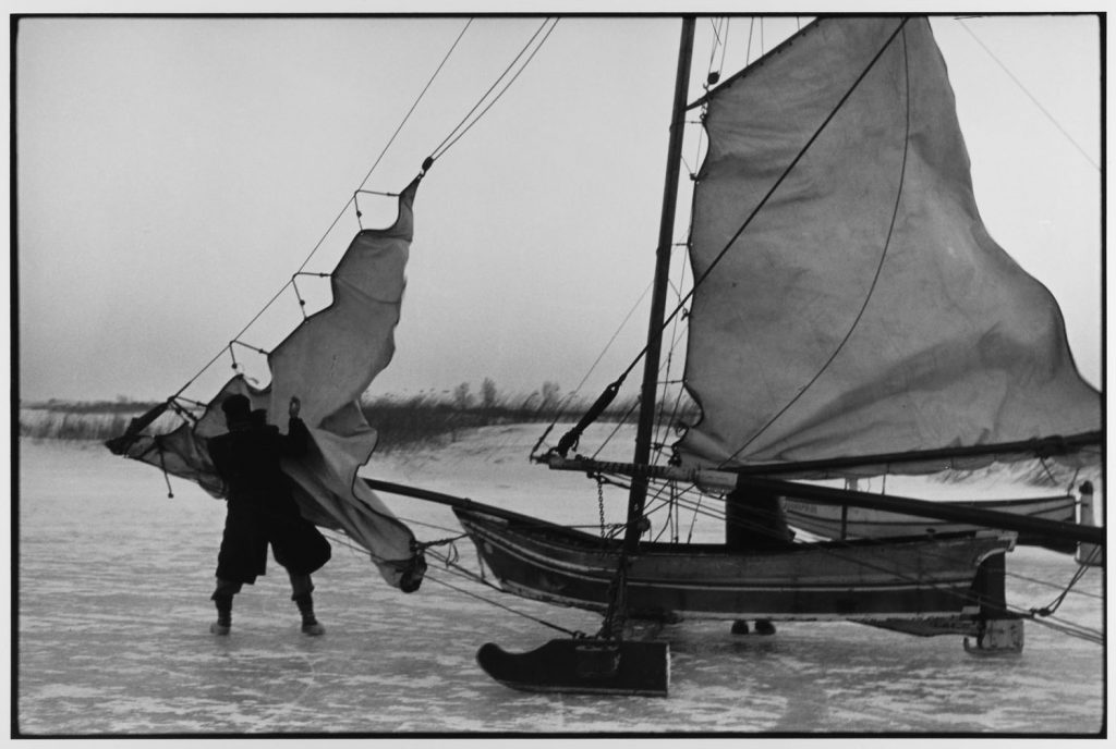 Rigging ice boat sails on the Yzer Meer Holland, 1964 by Leonard Freed