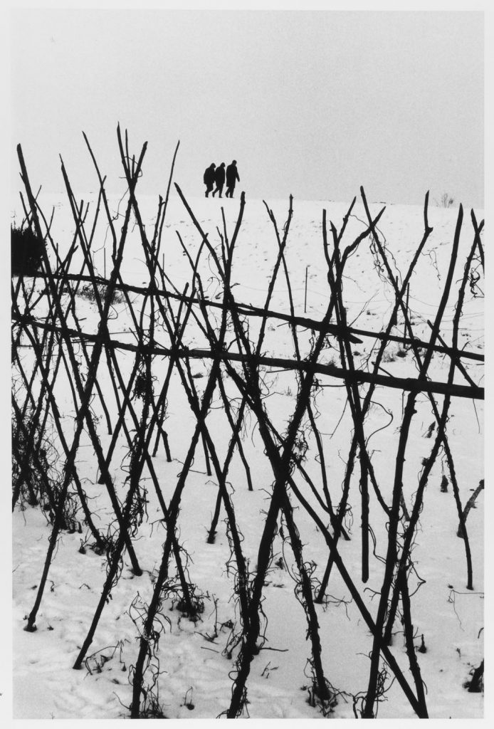 Three figures on horizon, Holland, 1964 by Leonard Freed