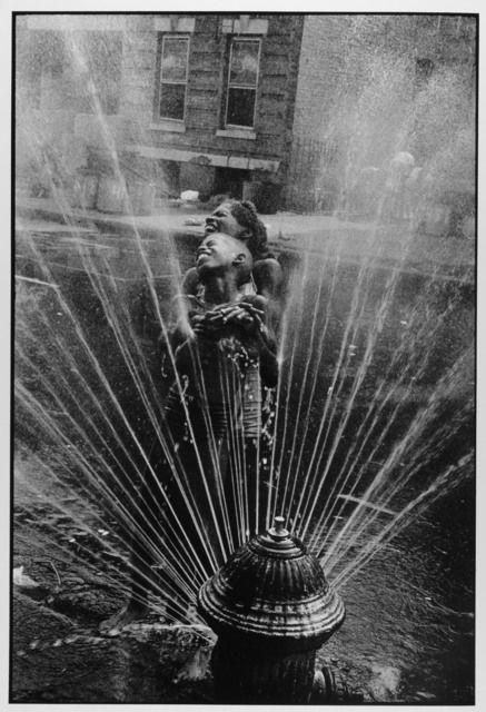 Fire Hydrant Fun, Harlem, NYC, 1963 by Leonard Freed