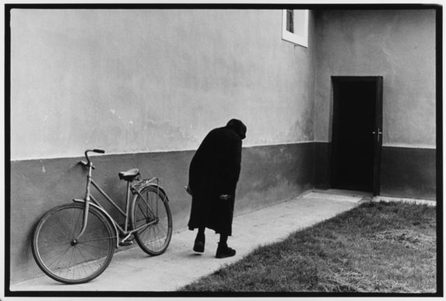 Old Woman and Bicycle Hungary, 1984 by Leonard Freed
