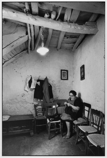Woman sewing at home, Madonie Mountains, Sicily, Italy, 1974 by Leonard Freed