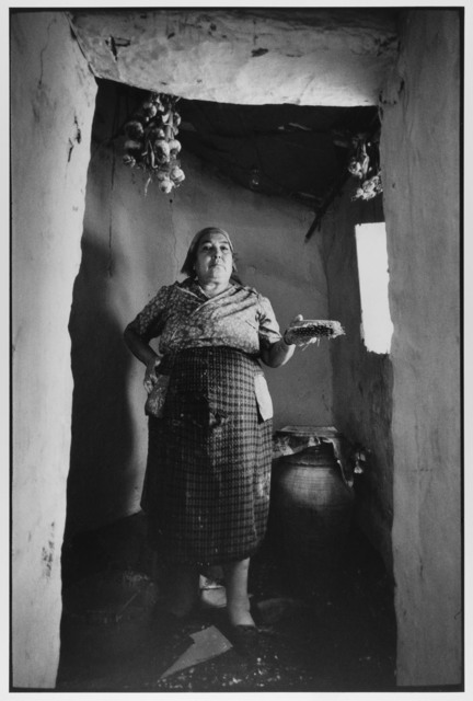 Village Woman painting her home white, Madonie Mountains, Sicily, Italy, 1974 by Leonard Freed
