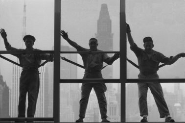 Three United Nations Window Washers, 1950 by Nat Fein