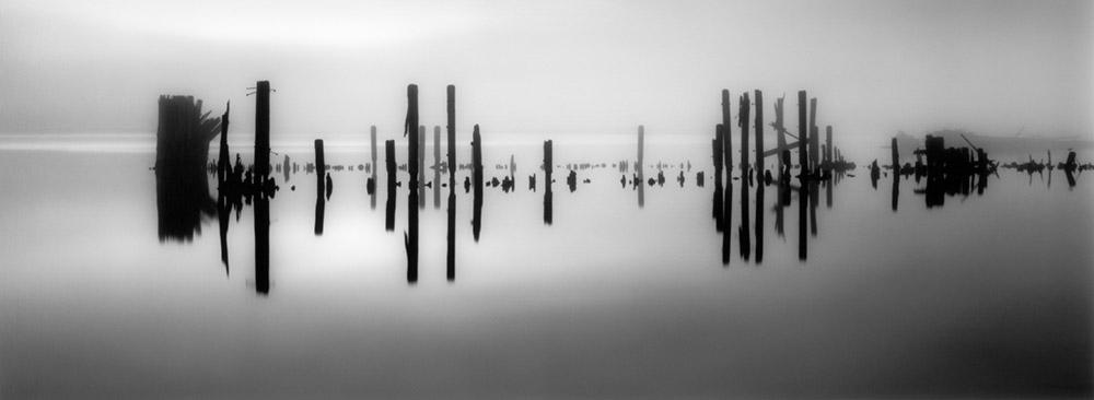 Pier Pilings in Still Water, 2012 by Brian Kosoff