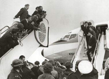 The Beatles Arrive in the US on Pan Am, 1964 by Terry O'Neill