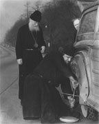 Russian Orthodox Priests Change Tire, 3/10/1955 by Nat Fein