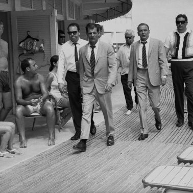 Singer and actor Frank Sinatra, with his minders and his stand in (who is wearing an identical outfirt to him), arriving at Miami beach while filming, 'The Lady In Cement', 1968. (Photo by Terry O'Neill/Getty Images)