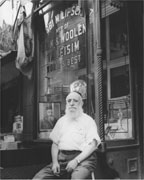 Rabbi Lipschitz In Front of Store by Nat Fein
